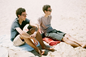 two-guys-sitting-by-the-beach-1697311